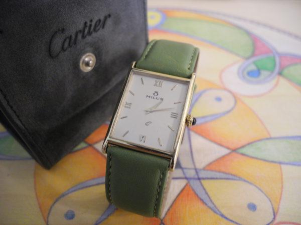 Seltene MILUS 14 K 585 Gold Damenuhr mit Cartier 18 K 750 Gold Saphir-Krone